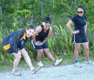 Stretching time: athletes warm-up before a NAA fun-run